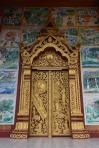 Detall d'un dels temples de Luang Prabang ple de murals pintats